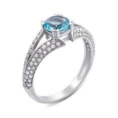 Серебряное кольцо с голубым топазом и фианитами 000129360 16.5 размера от Zlato
