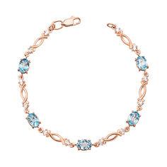 Золотой браслет в красном цвете с голубыми топазами и фианитами 000125366 19 размера от Zlato