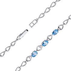 Браслет из белого золота с голубыми топазами и фианитами 000132836 17.5 размера от Zlato