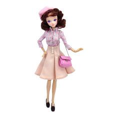 Акция на Кукла Kurhn Модница в клетчатой рубашке и персиковой юбке (6938142030835/3083-2) от Будинок іграшок