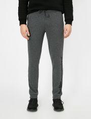 Акция на Спортивные штаны Koton 0YAM41239LK-027 L Grey (8682260071000) от Rozetka